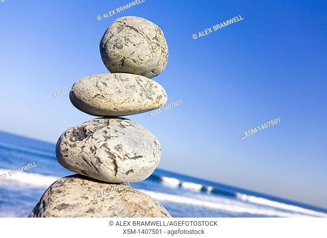 Stone stack with blue sky and angled horizon