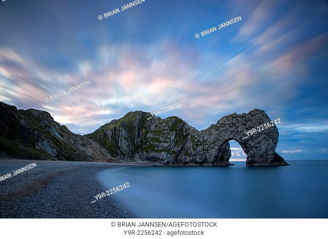 Colorful sky at dawn over Durdle Door along the Jurassic Coast, Dorset, England