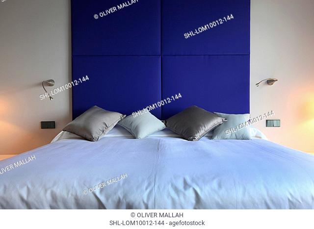 Blue headboard above bed