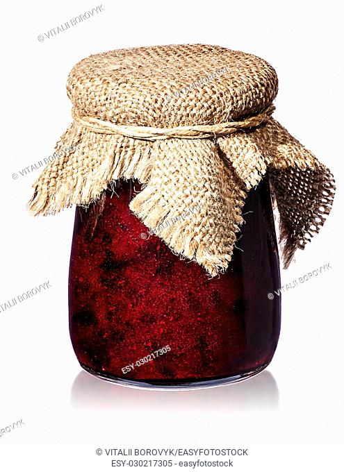 Currant jam in jar with burlap isolated on white background