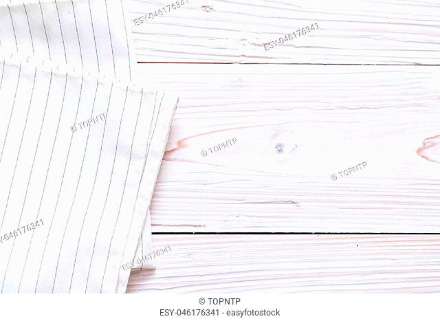 kitchen cloth (napkin) on wood background with copy space