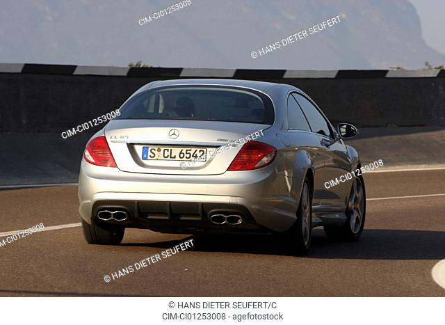 Mercedes CL 65 AMG, model year 2008-, silver, driving, diagonal from the back, rear view, country road