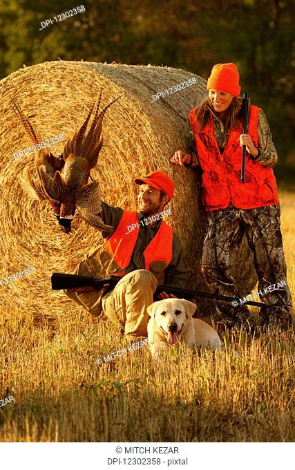 Male And Female Pheasant Hunters