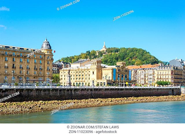 The Urumea river is passing through the Basque city of Donostia San Sebastian. View ahead to the Maria Cristina bridge and the district Gros