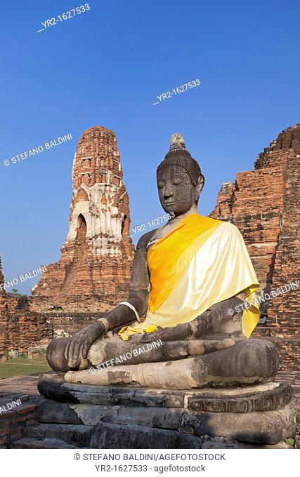 Buddha Statue amid the ruins of Wat Phra Mahathat, Ayutthaya, Thailand