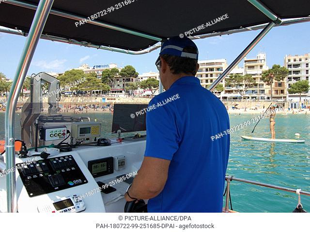 10 July 2018, Spain, Mallorca, Porto Cristo:Joan Adrover patrols the coast of Porto Cristo with his cutter. More than a dozen boats are on duty at the coast...