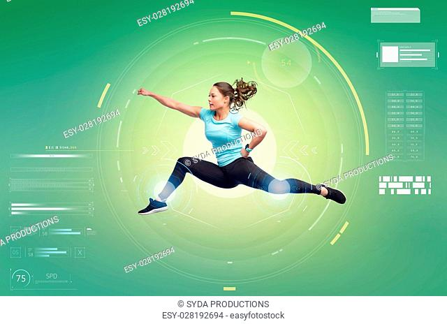 sport, fitness, technology, motion and people concept - happy young woman jumping in air in fighting pose over white background