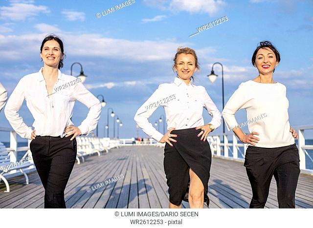 Group of businesswomen walking outdoors