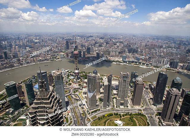 View from the observation level of the 492 meter high World Financial Center in Pudong of downtown, the Oriental Pearl Television Tower