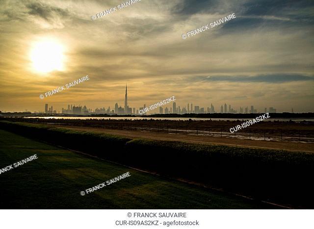 Distant view of Burj Khalifa and city skyline at dawn, Dubai