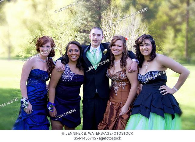 Young people in prom clothes at the park