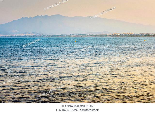 European sandy beach and blue sea, Mar Menor. Retro tobed