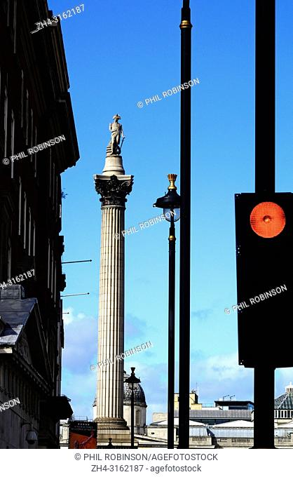 Nelson's Column, lampposts and traffic lights in Whitehall, Westminster, London, England, UK