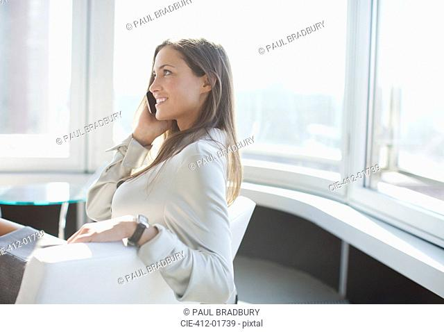 Businesswoman talking on phone in office