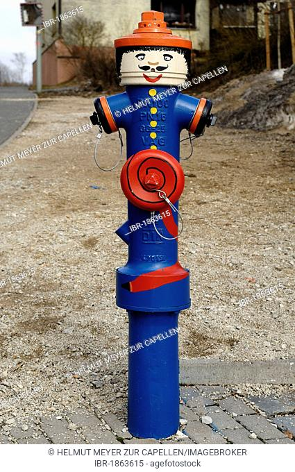 Water hydrant painted as a fireman, Ittling, Upper Franconia, Bavaria, Germany, Europe