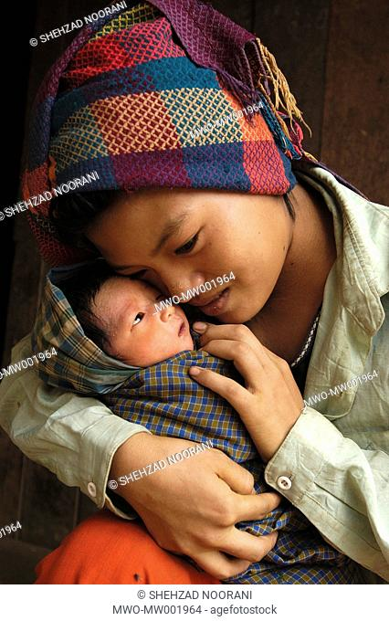Hteik Hteik Soe 18 years old holds her 8 days old newborn baby in her arms, in Taung Pet village, about 4 hours walking distance from Kalaw in Southern Shan...