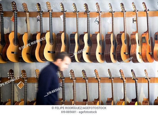 Guitars in a music store. Seville, Andalusia, Spain