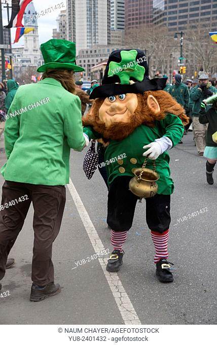 Handshake of two men in geen carnival costumes of Irishmen, St. Patrick's Day Parade, Philadelphia, USA