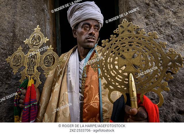 Priest with anceint religious relics. Asheton Maryam Monastery. Lalibela. Ethiopia