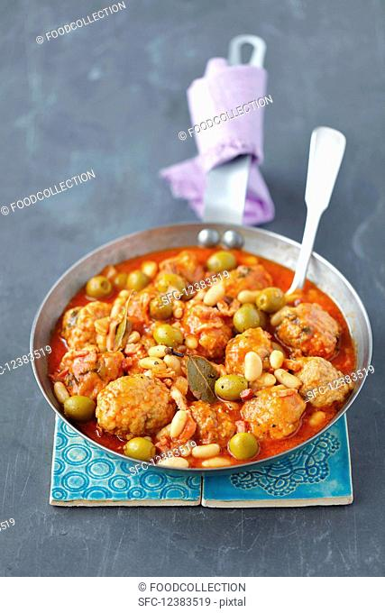 Pork meatball stew with green olives and beans