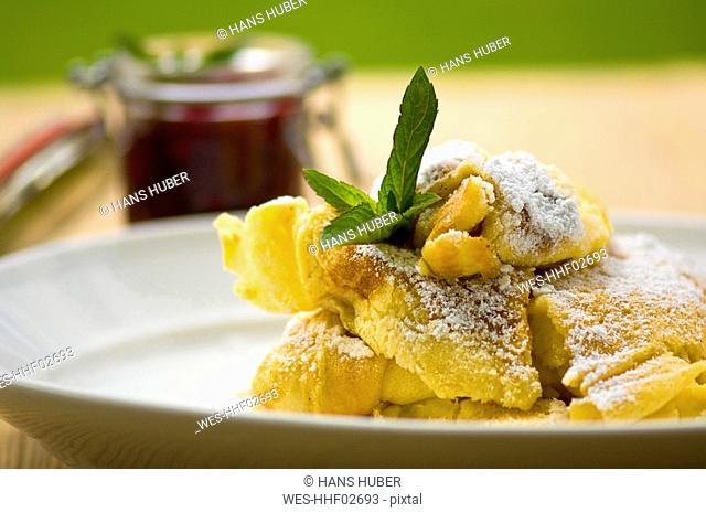 Cut-up pancake on plate, close-up