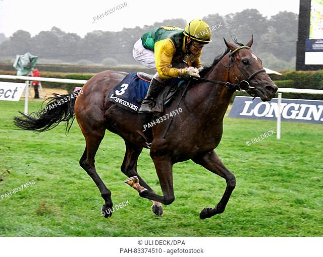 Jockey Ian Ferguson and his horse Iquitos winning the 144th Grand Prix of Baden at the 'Grosse Woche' equestrian event at the gallop race track in Iffezheim