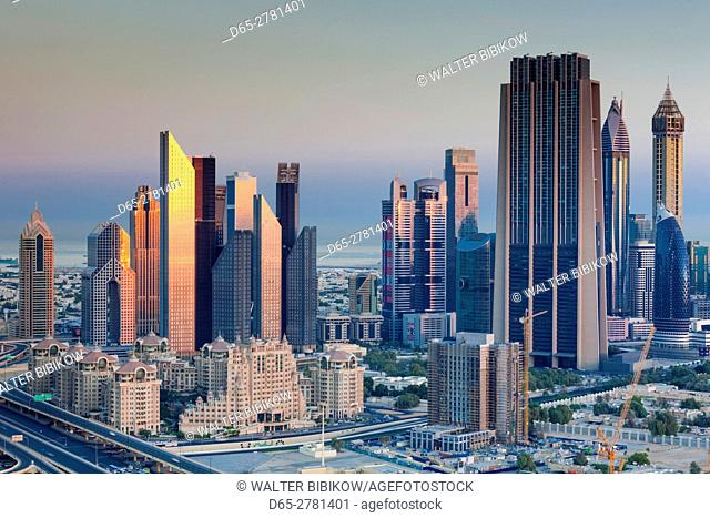UAE, Dubai, Downtown Dubai, elevated view of skyscrapers on Sheikh Zayed Road from downtown, dawn