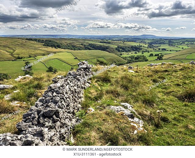 Looking into Malhamdale from a viewpoint above Gordale Scar with Pendle Hill on the horizon Yorkshire Dales England