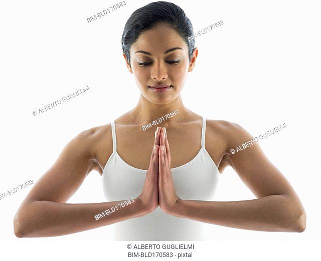 Close up of serene woman meditating