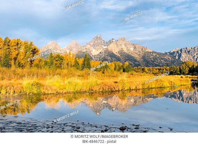 Autumn landscape with Grand Teton Range mountain range, reflected in the river, Snake River, Grand Teton National Park, Wyoming, USA