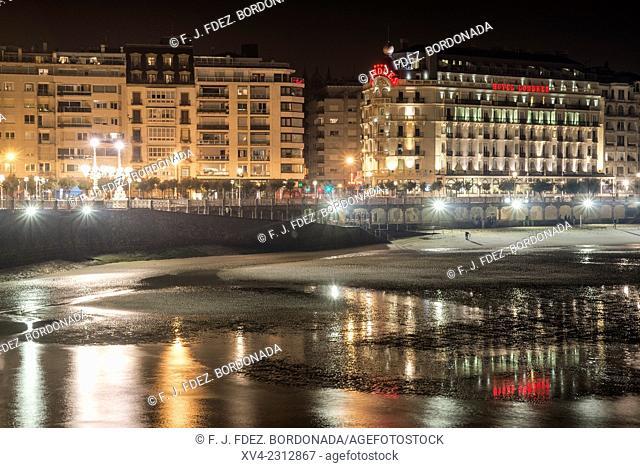 La Concha Beach. Old town of San Sebastián by night. Donostia, Basque Country, Spain