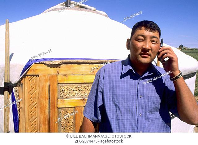 Nomadic Villager next to Ger on Cell Phone in Mongolia