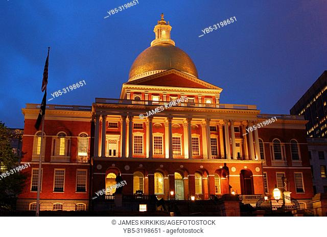 The Massachusetts State House in Boston is illuminated at dusk