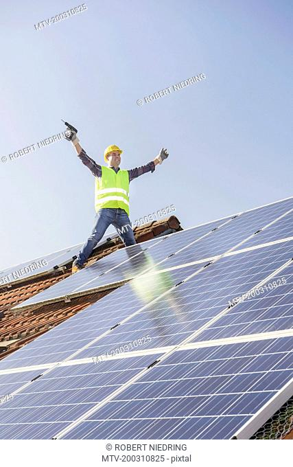 Successful engineer with solar panels on roof