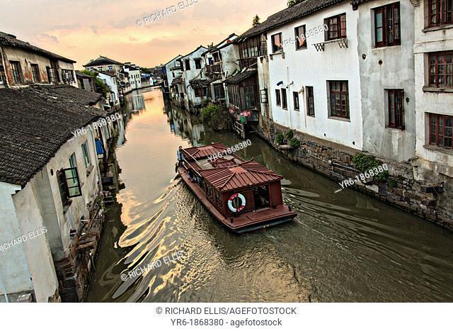 Boat travels along Shantang canal in Suzhou, China