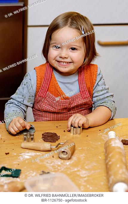Girl baking cookies for Christmas