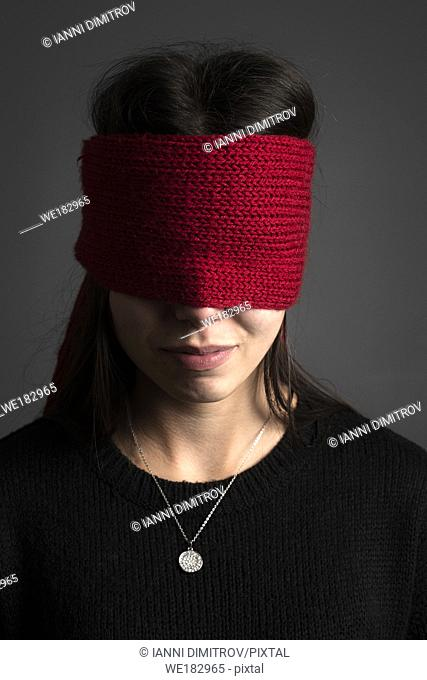 Young girl in red blindfold