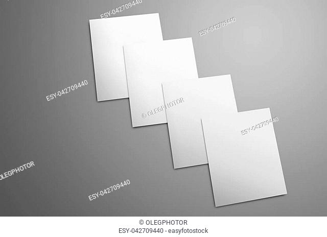 Universal mockup with white four A4, (A5) bi-fold brochures isolated on gray background. The booklets lie in order one on one the each top brochure is pushed...