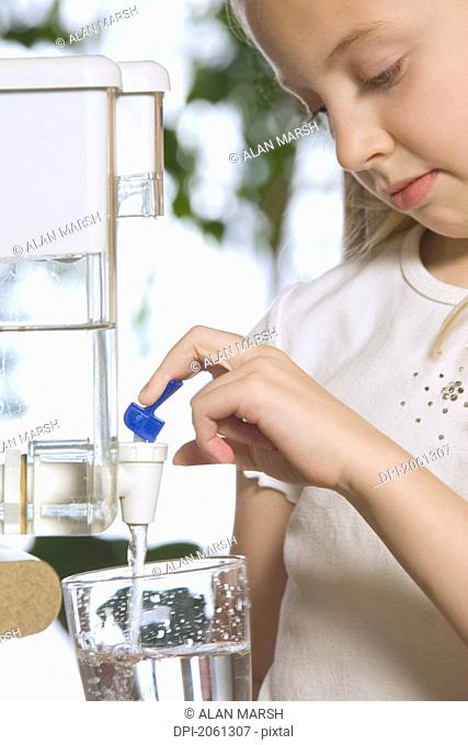Young Girl Pouring Filtered Water
