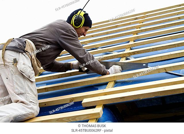 Builder at work on new structure