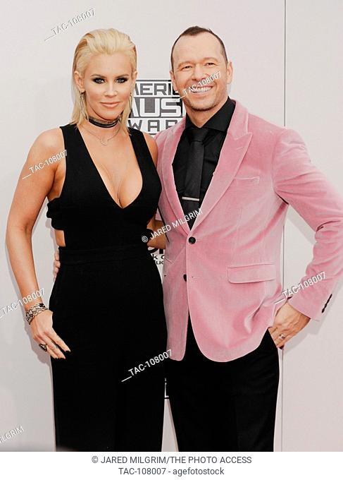 Jenny McCarthy and Donnie Wahlberg arrive at the 2016 American Music Awards at Microsoft Theater on November 20, 2016 in Los Angeles, California
