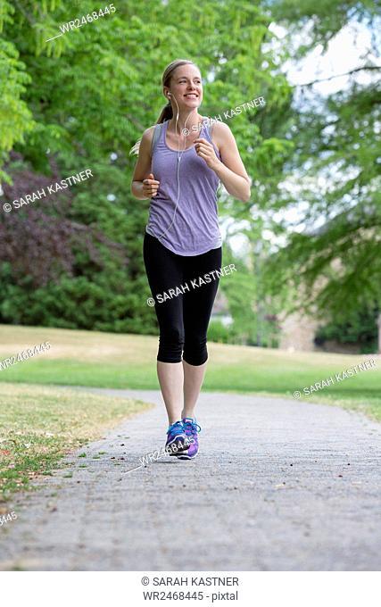 Woman jogging through the park
