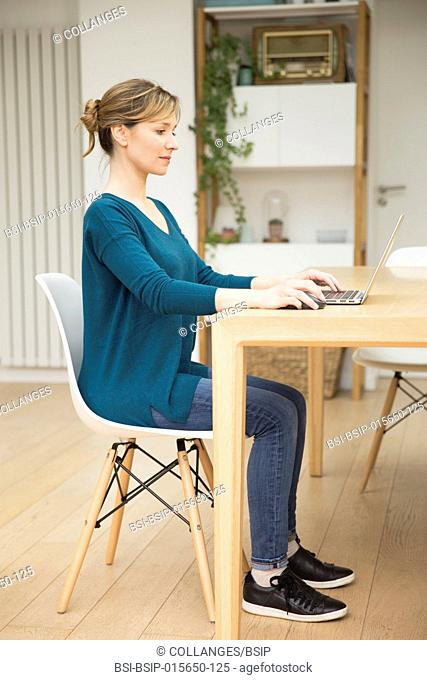 Woman using laptop. Correct seated posture