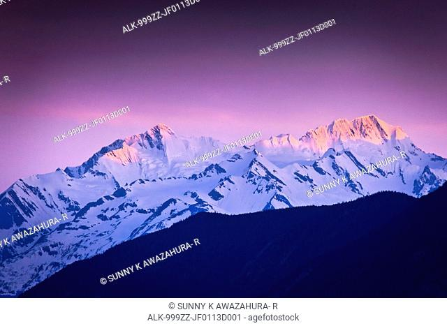 Alpenglow on Chilkat Mountains at sunset, Inside Passage near Haines, Southeast Alaska, Summer