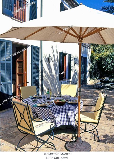 Laid table on Mediterranean terrace