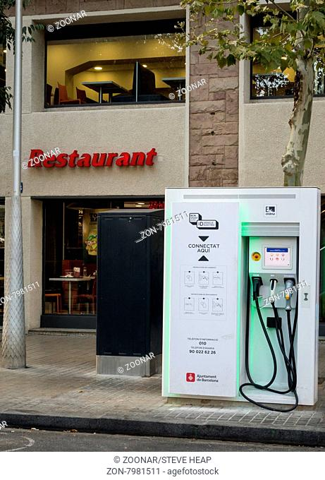 Electric vehicle charging station to recharge electric cars by street side in Barcelona Spain