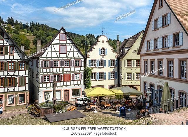 old houses of Schiltach, Black Forest, Germany, market place of the historical town with well and pavement café and half timbered-houses