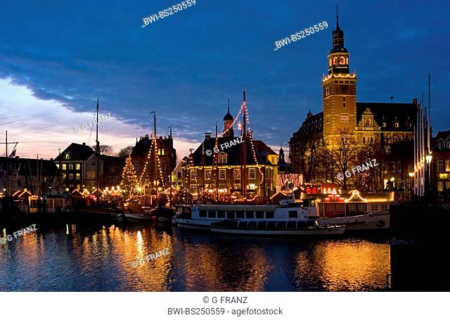 view at the illuminated Christmas market at the harbour, Germany, Lower Saxony, Leer