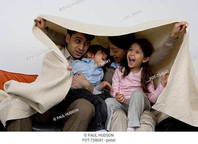 A family of four playing around