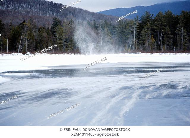 Strong winds blow snow across Church Pond in the White Mountains, New Hampshire USA  This area was part of the Swift River Railroad era